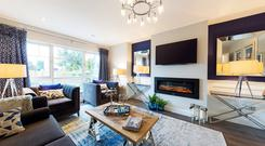 The main living room area is generously sized and a perfect space for relaxing – unusually, it is separated from the open-plan kitchen and living/dining room