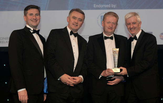 Michael Cosgrave, Patron of DIT Doctorate, second right, presents the Property Conservation Project Award to, from left, Brian Kavanagh, Fergal Ryan and Maurice Blake of Kavanagh Tuite Pic: Iain White