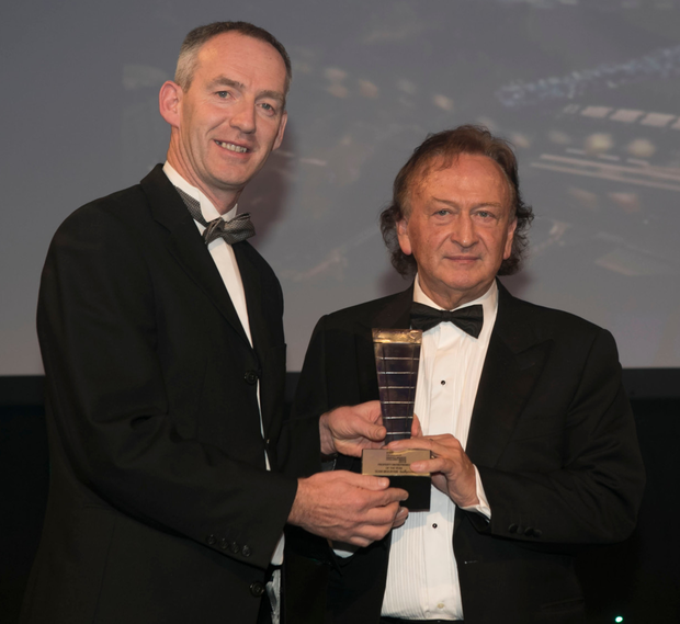 Sean Mulryan receives Property Entrepreneur of the Year Award from Pinergy CEO Enda Gunnell. Pic: Ian White