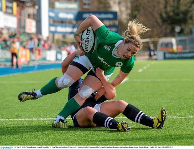 On the ball: Niamh Briggs is tackled by Scotland's Lisa Martin during a Women's Six Nations Rugby Championship match last March. Photo: Seb Daly / SPORTSFILE
