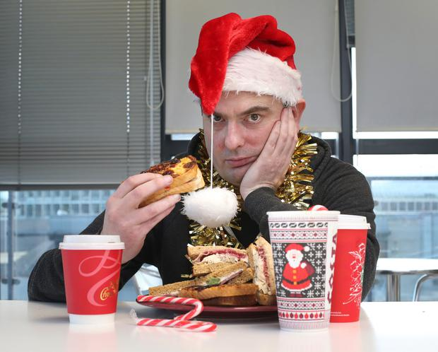 Where's the mistletoe and wine?: Ian O'Doherty tries a turkey and cranberry sauce sandwich, washed down with a ginger and cream latte Photo: Frank McGrath