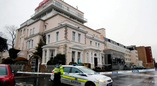 Shocking: A garda cordon outside the Regency Hotel in Dublin after one man died and two others were injured following a shooting incident at the hotel last February
