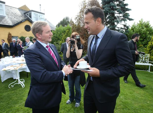 Young pretender: Enda Kenny with Leo Varadkar. Photo: Damien Eagers