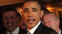 Barack Obama enjoying a pint of Guinness in Ollie Hayes Bar in Moneygall, Co Offaly during his 2011 visit