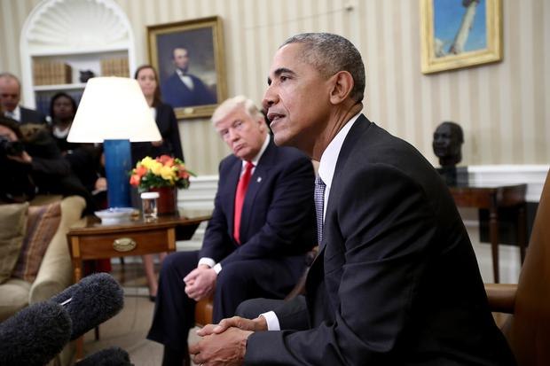 Donald Trump listens as Obama speaks during a meeting in the Oval Office following Trump's election in November