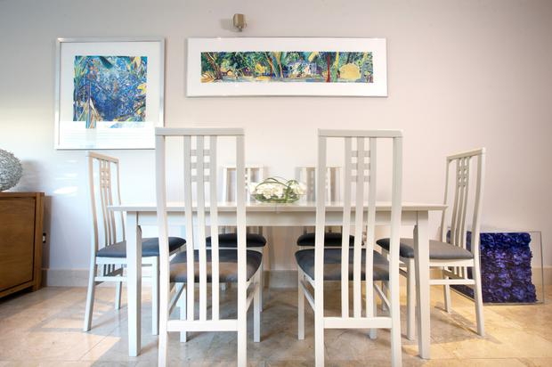 The dining table and chairs were dark until they were sprayed cream by Philip McKinney