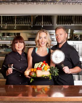 Kathryn Thomas with Pure Results chefs Michelle McCormack and Shane Rigby. Photo: Naomi Gaffey