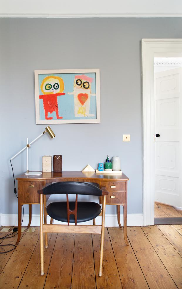 The painting, above the mid-Century-modern desk was given to Helle for her 40th birthday by her sister. It's by Danish artist Poul Pava. 'People have asked me,