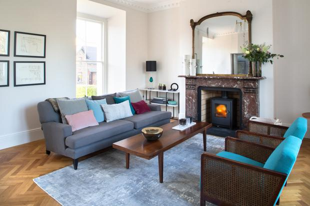 Helle installed a parquet floor in the more formal living room and she put a solid fuel stove in the period fireplace, as the lofty rooms are hard to heat. Like all the living spaces, the background is neutral but she introduces colour in the accessories