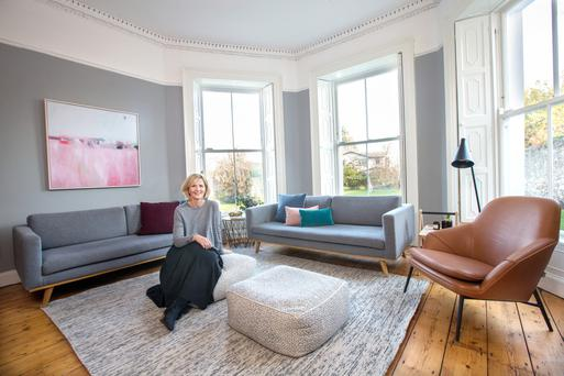 Helle in one of her living rooms, which is full of light, courtesy of its many period windows. The house is listed, so its sash windows had to be renovated in a particular way.The furnishings are mainly Danish designs. Photo: Tony Gavin