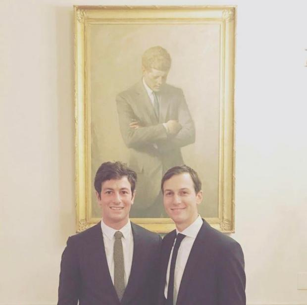 Joshua with his brother Jared at the White House, under a portrait of JFK