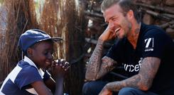 Living for the applause: UNICEF Goodwill Ambassador David Beckham meets Sebenelle (14) in Swaziland