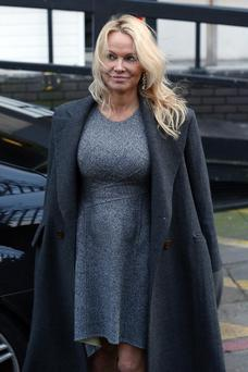 A newly demure Pamela Anderson earlier this month. Photo: Neil Mockford