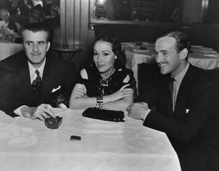 Hollywood royalty: Cedric Gibbons (left) with Dolores Del Rio and David Niven at the Trocadero Cafe in Los Angeles for Connie Bennett's birthday party, 1943. Photo: Hulton Archive/Getty Images
