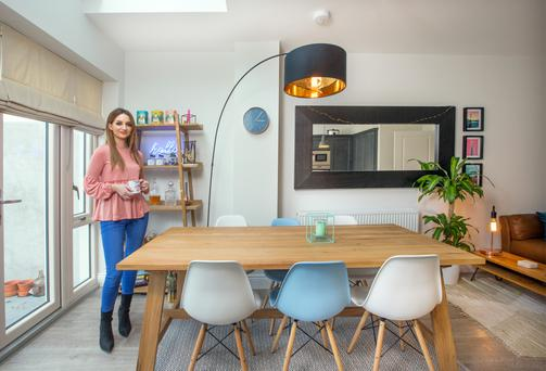 Caroline in her dining area; the Eames-style chairs are from Zinzan and the lamp over the table is from made.com