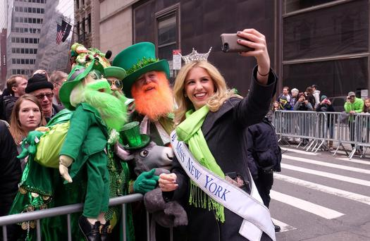 Miss New York Kira Kazantsev takes a selfie during the 2015 St Patrick's Day parade in New York. Photo: Jewel Samad/Getty