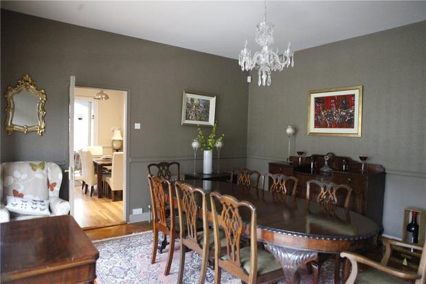 The dining room with hardwood floors