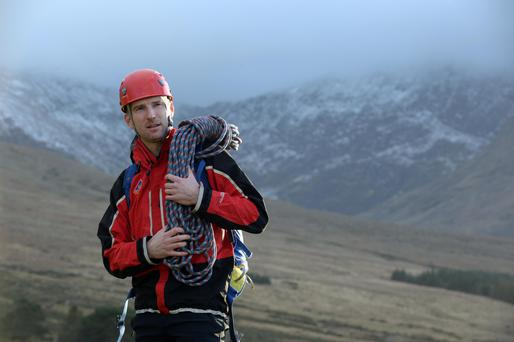 Kerry Mountain Rescue volunteer Colm Burke near Ireland's highest mountain, Carrauntoohil, in the McGillycuddy Reeks in Co Kerry. Photo Don MacMonagle