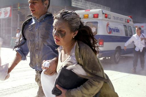 Horror unfolds: People flee the scene near New York's World Trade Center after terrorists crashed two planes into the towers on September 11