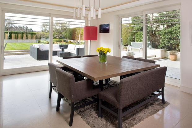 The dining area looks out on the beautifully manicured gardens and patio area. The table, bench and chairs are from Belgium