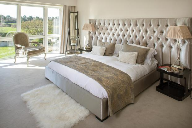 "Kate designed the headboard in the master bedroom and had it made in Northern Ireland. It's not just a headboard, it has all the electrics in it,"" she explains"