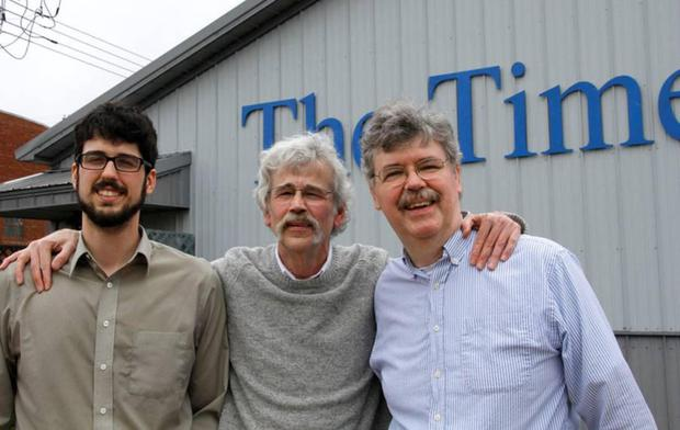 Family affair: Art (centre) with son Tom and brother John (right), who started the paper from scratch 27 years ago