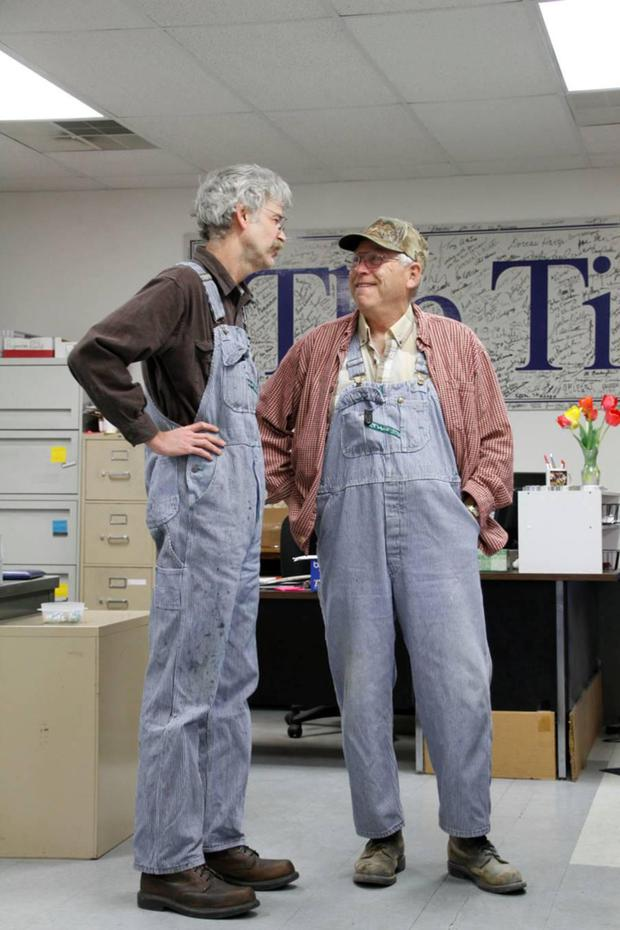 Art Cullen with a subscriber, also in overalls.