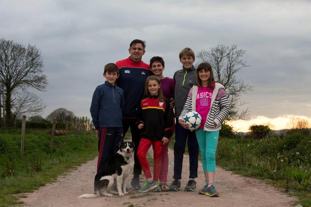 Dual identity: Lisa O'Connell with her family, husband Con O'Connell and children Liam (14), Sophie (12), Ben (11) and Aimee (8) at their family farm outside Cork City. Photo: Clare Keogh