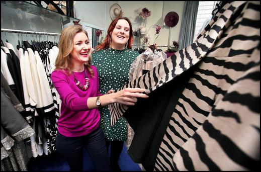 Personal shopper: Natalie Svikle with Toryn Glavin, an admin officer with TENI (Transgender Equality Network Ireland) at the Turret Boutique on Castle Market Street, Dublin. Photo: Steve Humphreys