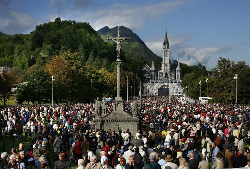 Dearly beloved: Visitors at the shrine in Lourdes