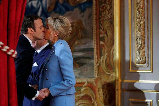 Up close and personal: the Macrons steal a kiss ahead of his inauguration
