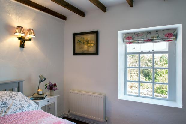 The original ceiling beams were retained throughout the house and the bedrooms are decorated simply, as befits a holiday home.