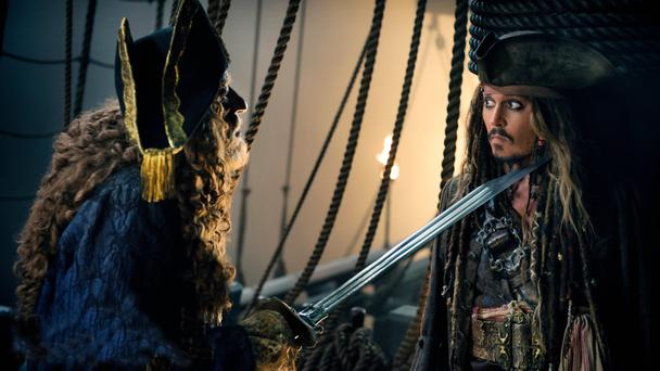 Geoffrey Rush and johnny Depp in a scene from Salazar's Revenge - the fifth in the Pirates of the Caribbean series