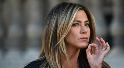 Hair we go: Jennifer Aniston takes Viviscal Healthy Hair Growth supplements and concealers