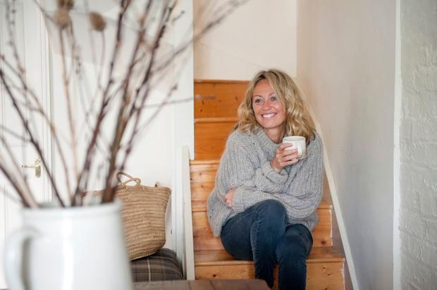 Clodagh relaxes on the stairs of her gorgeous London home -a three-storey 19th-Century coach house - that provides a haven from the demands of her hectic schedule