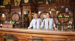 Passed through the generations: Sean and Ronan Lynch at the Swan bar on Aungier Street