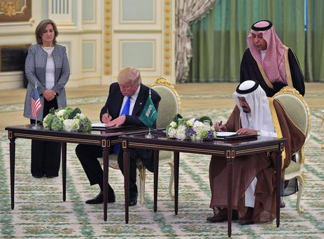 Arms deal: Trump and King Salman bin Abdulaziz al-Saud sign a trade agreement at the Saudi Royal Court last month. AFP/Getty Images