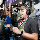 Changing demographic: Gamers visit Activision's Destiny 2 booth during E3 2017; and inset below, Xbox boss Phil Spencer at the event