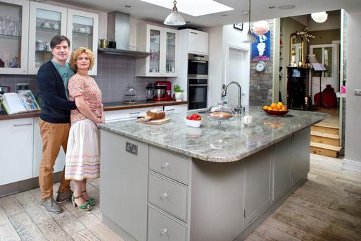 Mark and Gail Doherty in the large open-plan kitchen/dining room, which they added to their period home in Dublin 8. Large light wells in the roof and big expanses of glass ensure a bright, airy space. The units were made by a local carpenter, and the counter top is granite. The exposed brick is the original back wall of the house