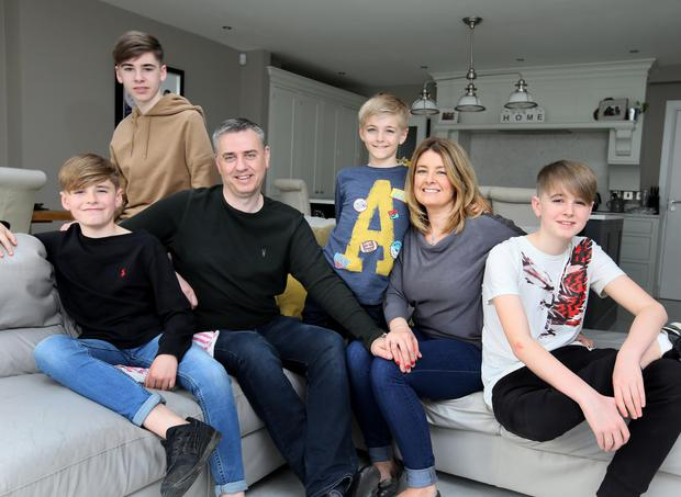 Sonya Reilly pictured with her husband Mark and their boys, Evan (11), Adam (17), Elliot (9) and Alex (14) at their home in Malahide. Photo: Frank McGrath