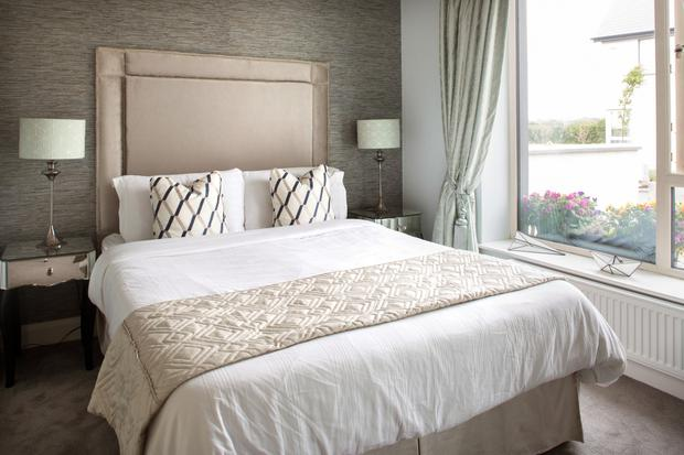 David, the youngest of Bill and Cora's three children still lives at home, and the 20-something's room is decorated in soft neutrals. The headboard on his bed is very on trend with this year's top feature - lots of studs
