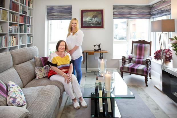 Cora and Lorna in the drawing room, which is decorated in grey and purple. The blinds are made from a Voyage fabric, which appealed to the family as it is reminiscent of a Monet painting