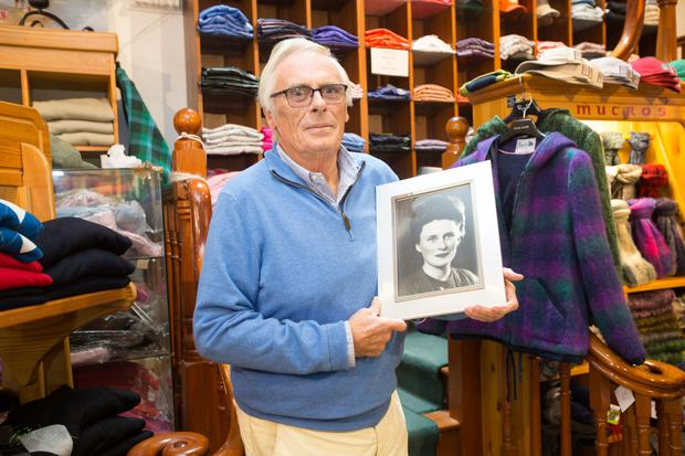 Donogh O'Loghlin, owner of Sue's on Main Street holds a photograph of his mum Sue. Photo: Liam Burke/Press 22