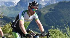 On his bike: Shane Phelan feels the burn while cycling through the Alps Photo: photobreton.com