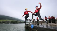 Leap of faith: Ryan Rafferty (13) and Shea Leadhem (15) from Dundalk during an activity run by Carlingford Adventure Centre. Photo: Frank Mc Grath