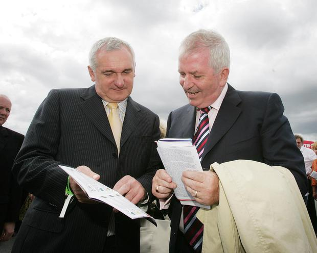 Former Taoiseach Bertie Ahern sharing some tips with then EU Commissioner Charlie McCreevy