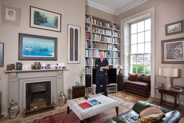 Eugene Downes, director of the Kilkenny Arts Festival, in his study with its magnificent Georgian windows.
