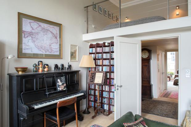 Left: Eugene Downes's home has two mezzanines, one of which is his bedroom. This is cantilevered above the study. The Beckstein piano is a legacy from his late Aunt Claire