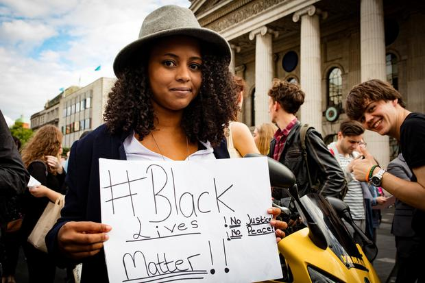 Sign of the times: A protestor with a #blacklivesmatter sign on O'Connell Street