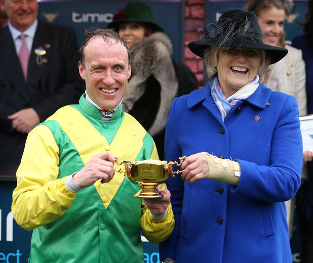 Jockey Robbie Power with Jessica Harrington after Sizing John won the Gold Cup at Cheltenham. Photo: Damien Eagers